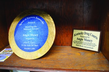 """Bobbie Curd/bobbie.curd@amnews.com Angie has some of her awards from her prior job up in her office, but said she hasn't even started to settle in completely yet. """"The next time you're here, you won't even recognize this office,"""" she said."""