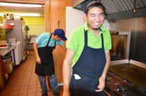 Israel, front, works with his older brother, Joseph, at La Hacienda.