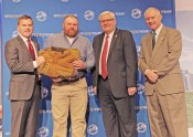 Photos contributed Jamie DeHart, of Mercer County Farm Bureau (center left), accepts the award from John Sparrow, Executive Vice President and CEO of KFB Insurance (left), Mark Haney, President of Kentucky Farm Bureau (center right), and Drew Graham, Executive Vice President of the KFB Federation (right).