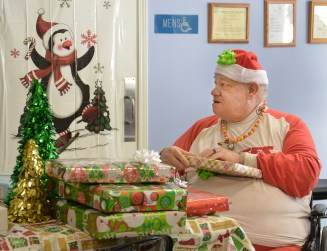 Robin Hart robin.hart@amnews.com Jimmy Russell is surrounded by gifts during the party at A Gathering Place Adult Day Health Care on Tuesday.