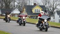 Photo by Robin Hart/robin.hart@amnews.com Steve Brashear, dressed as Santa, leads several members of the Brothers Code Motorcycle Club to Kerr Hall on Kentucky School for the Deaf campus Friday morning to deliver gifts to the students from club members.