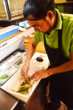 La Hacienda is probably best known for its authentic tacos, Israel says. Here, he fixes a to-go box with a vegetable burrito and two carnitas (pork) tacos, topped with cilantro, radish and lime.