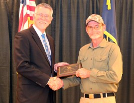 Joe Crabtree, PhD, PE, Director, Kentucky Transportation Center, shown at left, presents Russell Justice from the City of Danville the Roads Scholar Award.