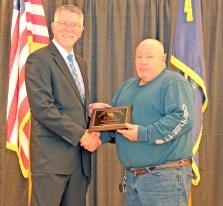 Joe Crabtree, PhD, PE, Director, Kentucky Transportation Center, shown at left, presents Raymond Holt from the City of Danville the Roads Scholars Award.