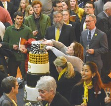 Robin Hart/robin.hart@amnews.com A five-tier birthday cake is sliced by a college employee during Centre's 200th anniversary celebration at Norton Center for the Arts Wednesday night.