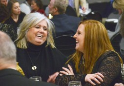 Robin Gardner, left, and Amber Hume enjoy the party at the Chamber of Commerce's 100th anniversary Friday night.