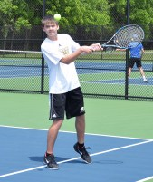 Boyle County's Kyle Burkett returns a serve during the doubles match against Wayne County. - they lost to Wayne county, who later lost to Somerset. (Photo by Robin Hart)