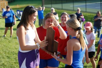 Mercer County players admire their trophy Monday after winning their second consecutive girls team championship at the 12th Region Tournament. (Photo by Mike Marsee)