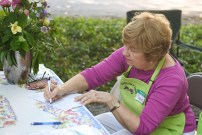 Sandy Reigelman signs in a guest during the garden tour in Danville on Saturday (Photos by John Scarpa.)