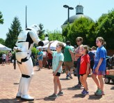 """A storm trooper gives a """"high five"""" to a student while others wait their turn to meet the character during the Boyle County Public Library's summer reading kickoff event. (Photo by Robin Hart)"""