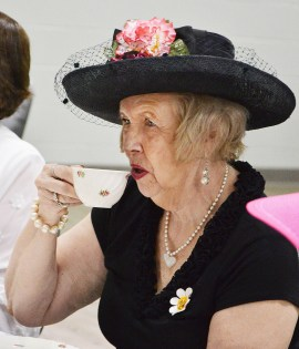 Barbara Pendleton, of Glassgow, is dressed for a formal tea Thursday afternoon. (Photo by Robin Hart)