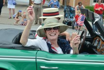 Bunny Scutchfield is having fun waving a small American flag and tossing candy in the parade. (Photo by Robin Hart)