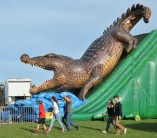 An enormous crocodile seems to be looming over fairgoers Tuesday. The inflatable slide can be seend from anywhere on the fairgrounds. (Photo by Robin Hart)