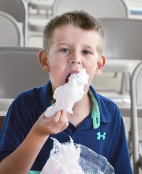 Ayden Davis, 8, of Harrodsburg, stuffs his mouth with cotton candy Wednesday night at the fair. (Photo by Robin Hart)