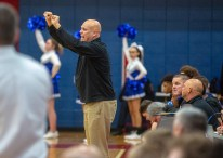 """Danville coach Ed McKinney coaches his team during a district tournament game in February. McKinney says the Admirals have a """"tough test"""" against Somerset in tonight's 12th Region semifinal game. (Photo by Ben Kleppinger)"""