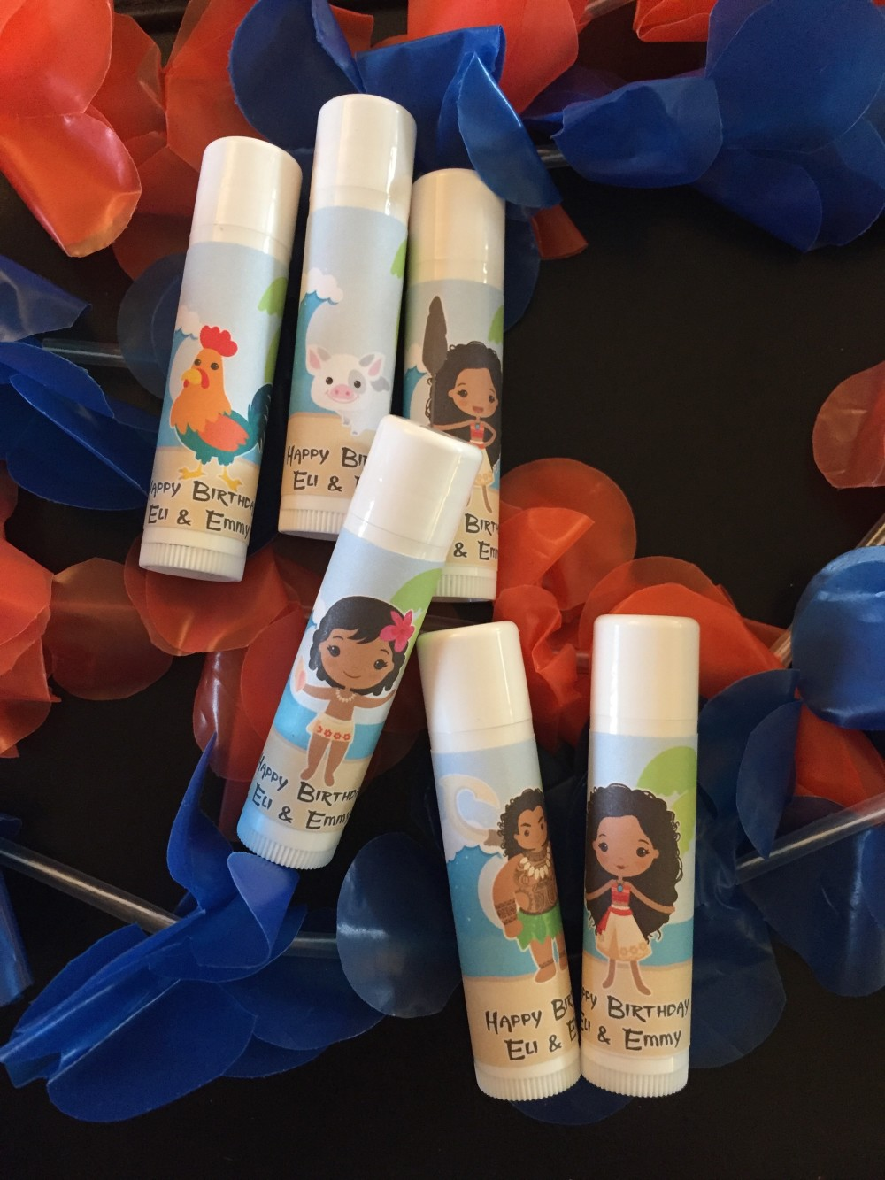 moana party favors // lip balms from Bolivia's party favors // a monkey and his mama