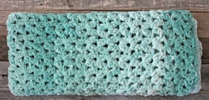 Make this quick and easy mist green chunky crochet blanket free pattern. super bulky chenille yarn - amorecraftylife.com -bernat blanket yarn -lap afghan - free printable crochet pattern - bernat blanket yarn #crochet #crochetpattern #freecrochetpattern