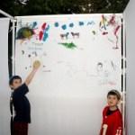 Children paint walls of their Sukkah