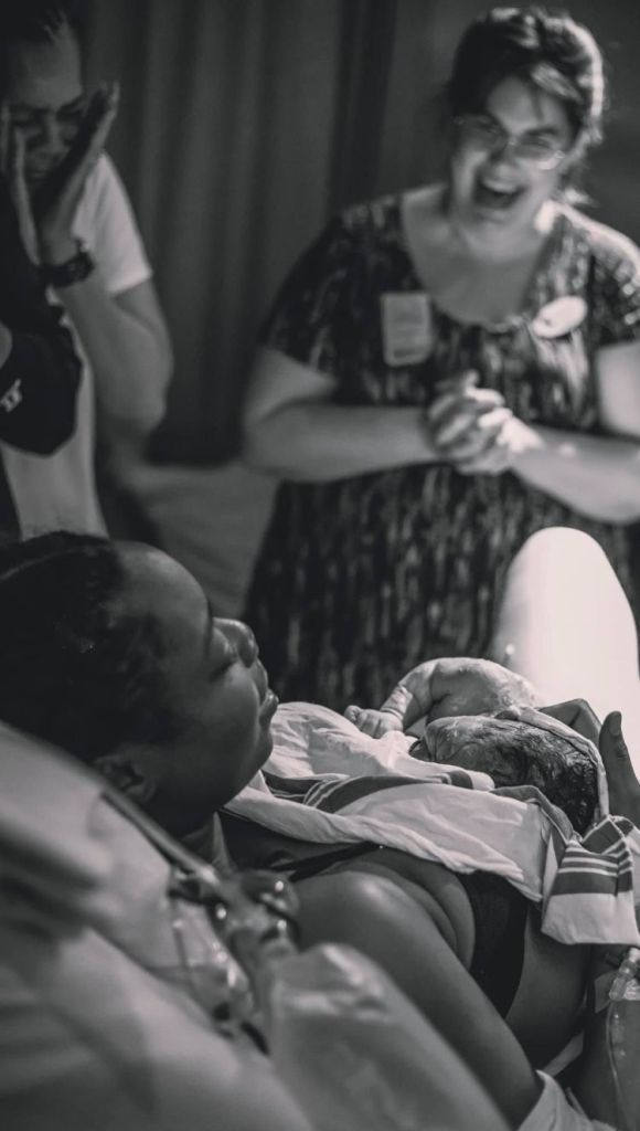 Doula Jenny Ervin with Upstate Family Doula cares for a mama during labor and birth