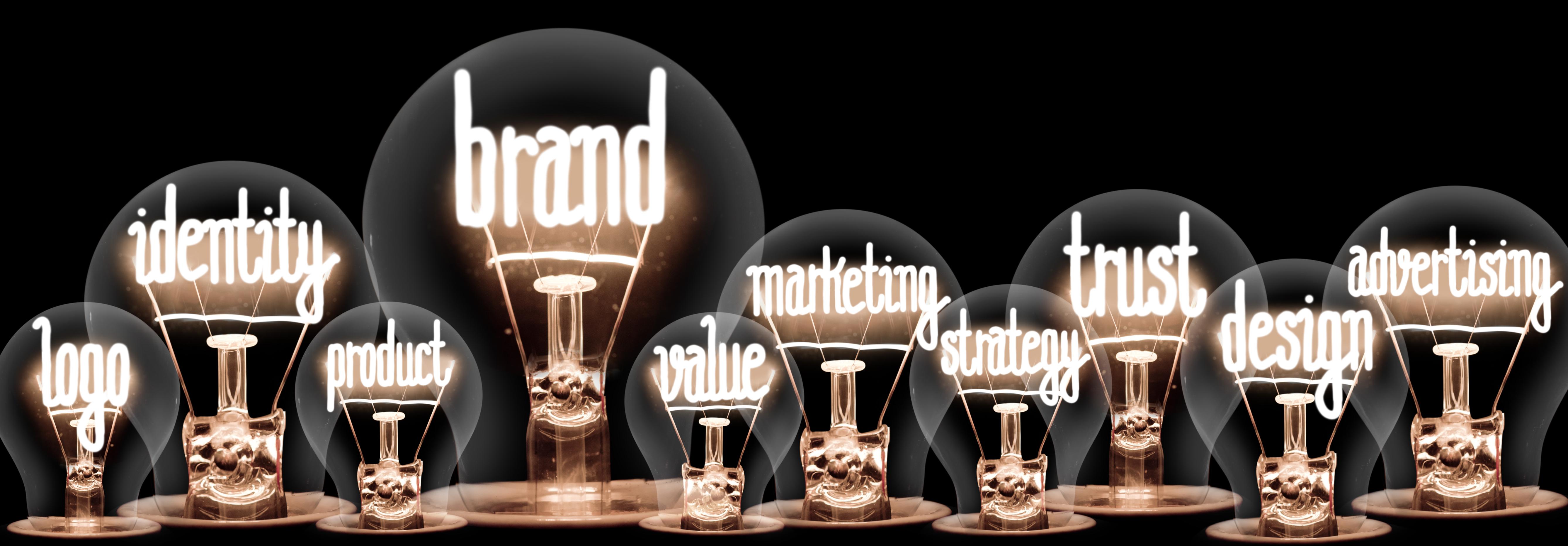 Branding and brand promise words as lightbulbs