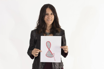 Ana Luisa Gonzalez holds up her curvy, DNA-like Ampersand