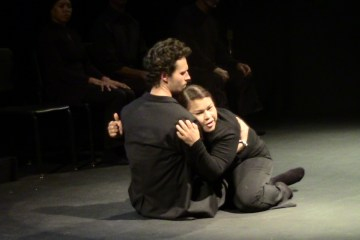 A woman collapses into a man's arms during LAPD's performance of Red Beard, Red Beard.