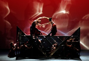 The dancers lock arms atop the disassembled cube. Photo Courtesy of