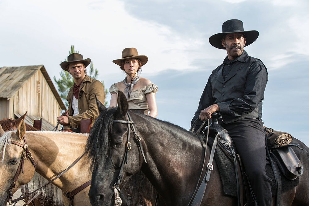 Denzel Washington, Haley Bennet, and Luke Grimes in The Magnificent Seven (Village Roadshow Pictures)