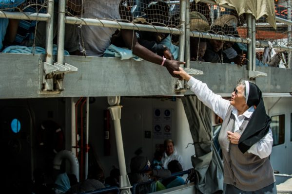 Migrants and Nun