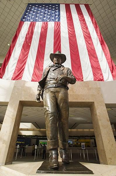 A statue of John Wayne on display at John Wayne International Airport. (Credit Image: © David Bro/ZUMA Wire)