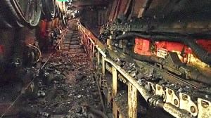 longwall coal burst incident showing coal from face inside longwall chocks