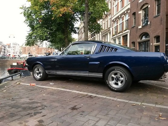 An awesome muscle car in front of the Nieuwmarkt (New Market) in Amsterdam.