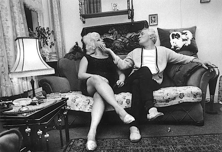 Blonde Mien and Haring Arie photographed by Erwitt Elliott in Amsterdam in 1968.