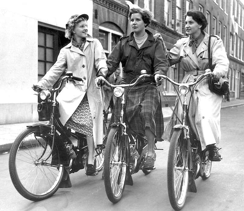 Young women on Mobylettes in Holland