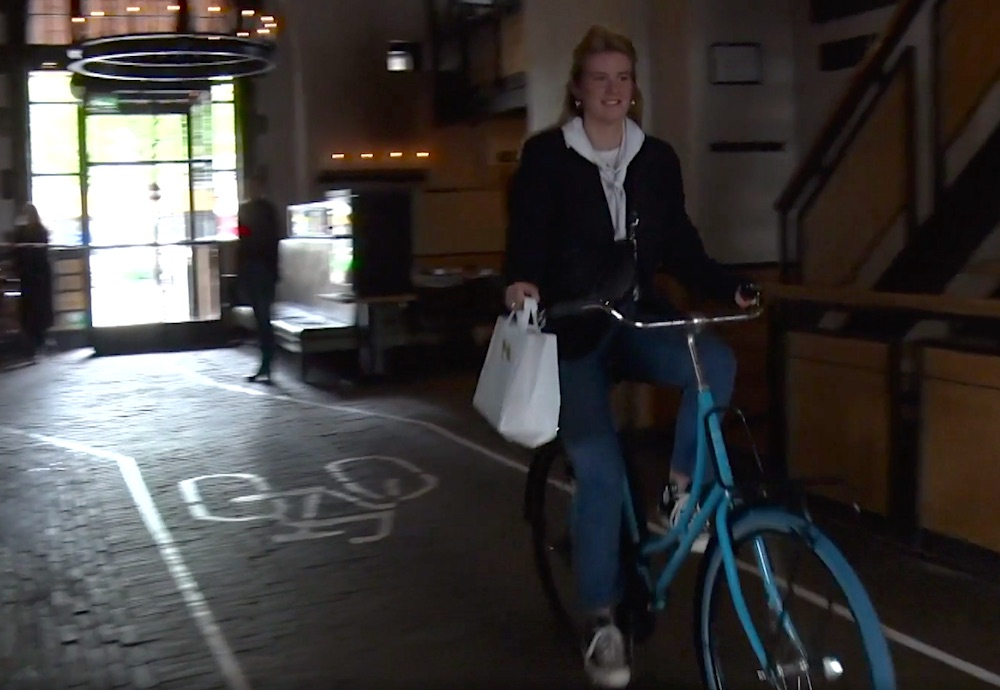 bike through restaurant in de waag Amsterdam