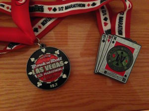 Side-by-side comparison of 2013 and 2014 medals. I like last year's better.
