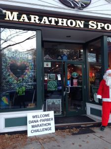 Santa greeting the DFMC runners at Marathon Sports in Wellesley.