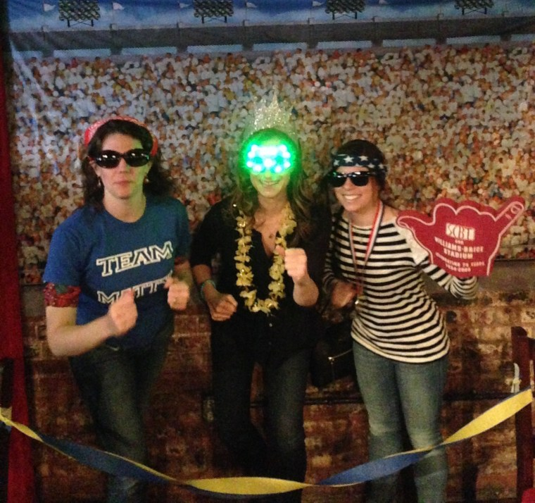 Goofing off at a Marathon fundraiser with two of my running buddies.