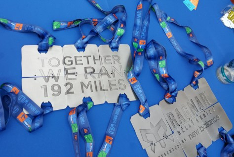 Our team medals fit together to reveal a SUPER SECRET HIDDEN MESSAGE on the back sides.