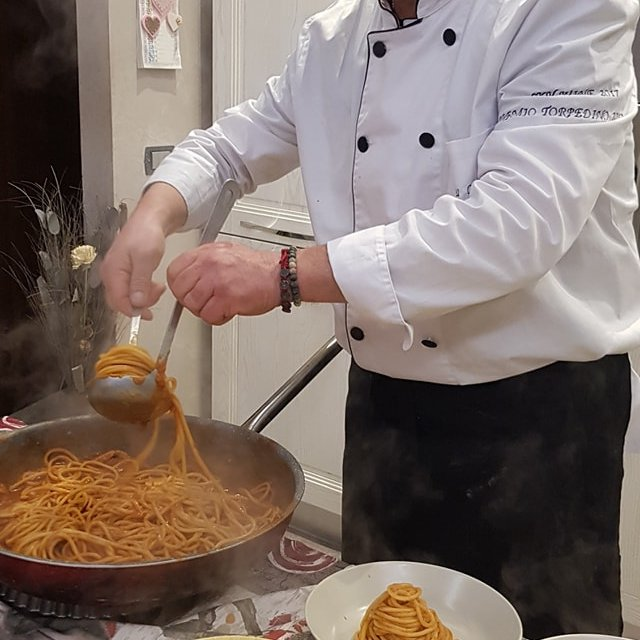 Chef Marco cooking spaghetti