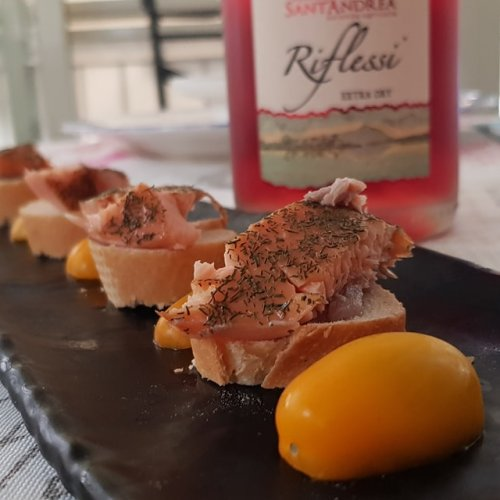 Fish appetizers and a bottle of rosé wine