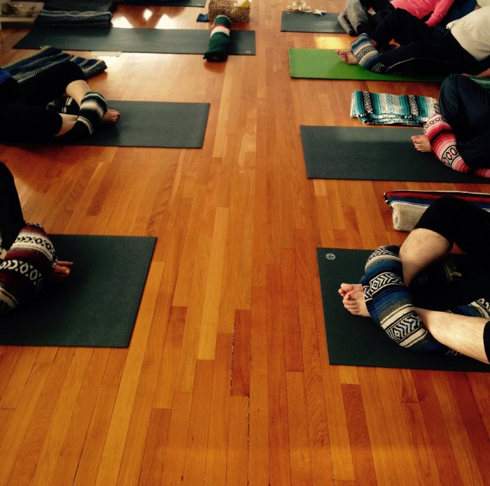 Students in restorative supported supine bound angle pose