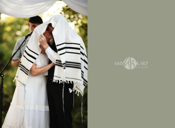 jewish wedding kiss under the tallit