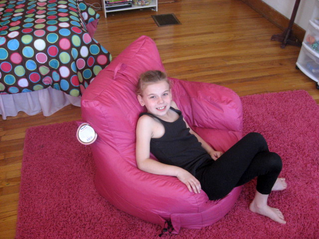 Girl in pink chair