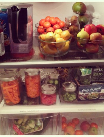 glass bowls and mason jars holding fruit and vegetables inside a refrigerator