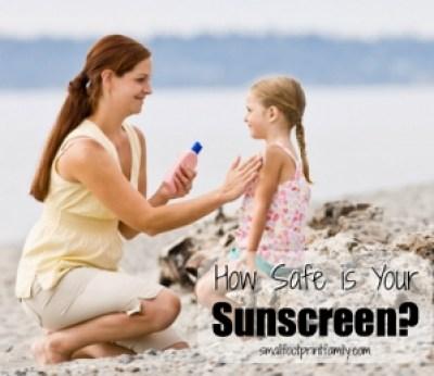 Woman put sunscreen on daughter