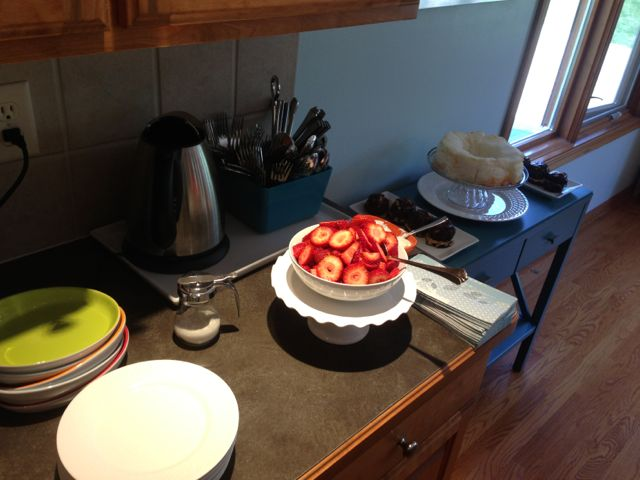 Large bowl of strawberries on a kitchen counter