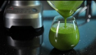 Green smoothie by a blender