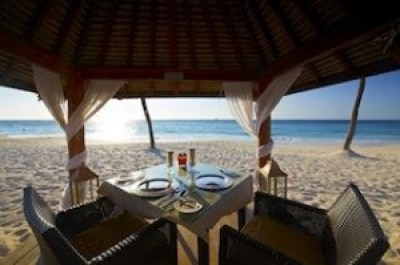 Table and chairs under a canopy in Aruba