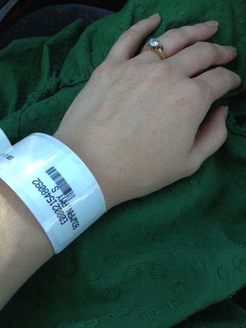 Hospital band on a breast cancer patient